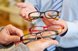 Optician offering choice of glasses