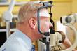 Man at eye measurement at ophthalmologist