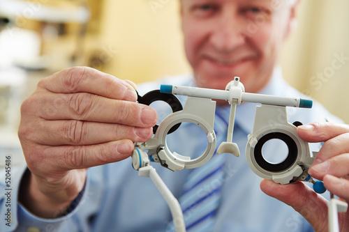 Fototapeta Optician with trial frame