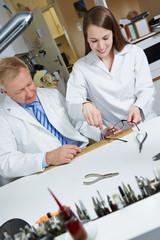 Apprentice in workshop of optician
