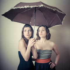 vintage portrait of two young women with umbrella