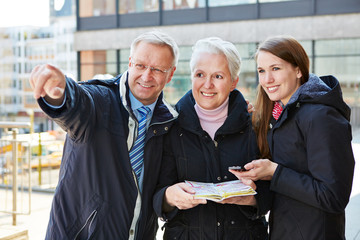 Family with map on sightseeing tour