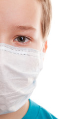 Teenager boy in surgical mask