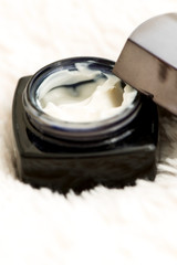 Cosmetic cream in jar close up shallow DOF