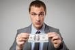 Portrait of a business man holding money
