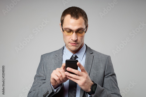 Young business man using a mobile phone