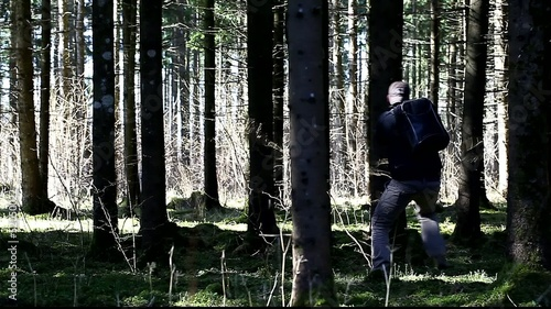 Robber chasing the traveler in the woods