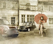 canvas print picture - Vintage image of young attractive girl with two old cars