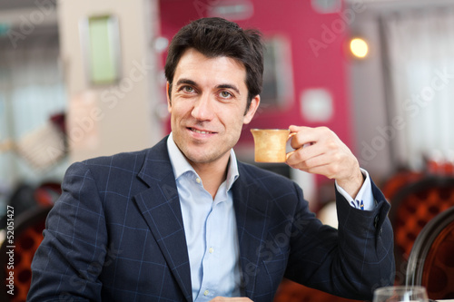Man having a coffee at the restaurant