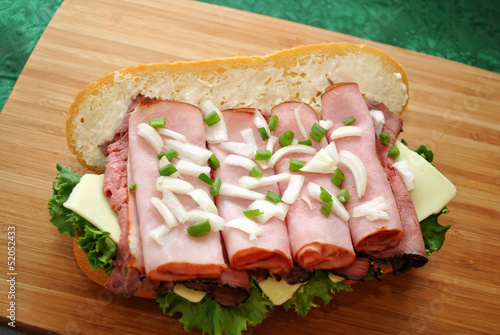 An Open Ham Deli Sandwich on a Cutting Board