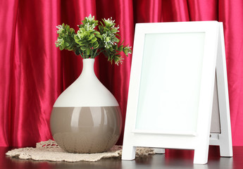 White photo frame for home decoration on curtains background
