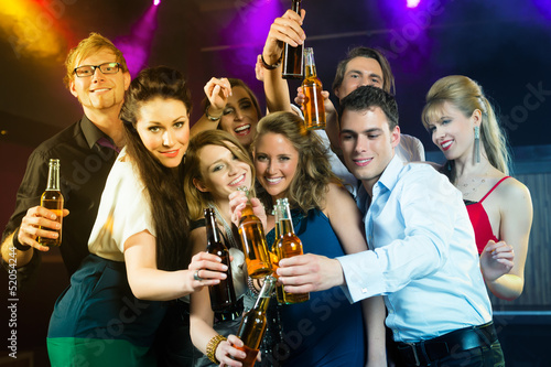 People in club or bar drinking beer