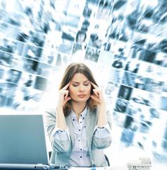 Businesswoman in a office feeling headache