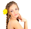 Young woman with beautiful hairstyle and flowers, isolated