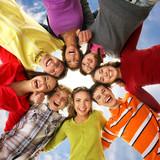 Teenagers on a light blue sky background