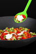 Vegetable ragout in wok, isolated on black