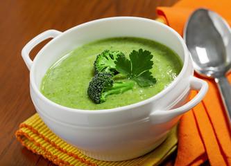 Broccoli cream soup on a tablecloth