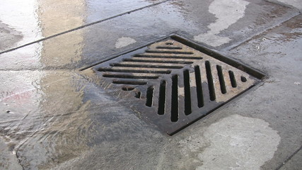 City drain. Water running down a city drain. Good audio.