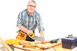 Middle aged male carpenter working in a workshop