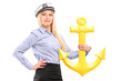 A young sailor woman with an anchor