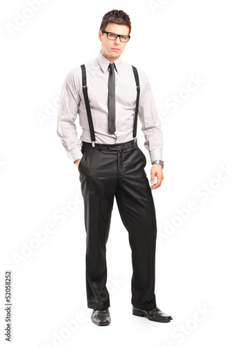 Full length portrait of a young stylish man looking at camera
