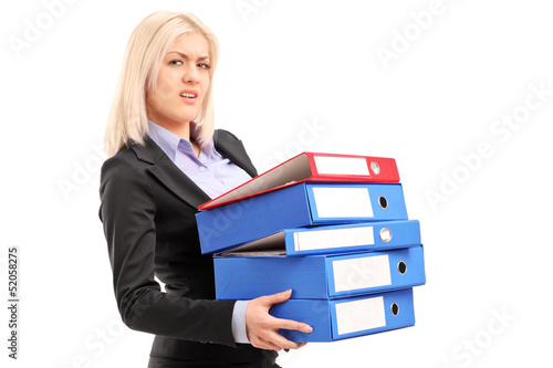 A young professional woman holding folders