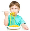 Little boy is eating spaghetti
