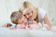 happy family with newborn baby at home