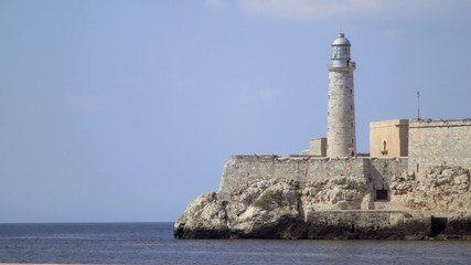 Lighthouse and Morro castle in La Habana, Cuba, with sea