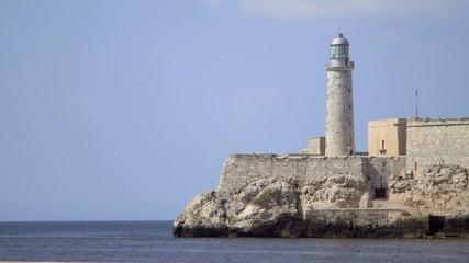 Lighthouse and Morro castle in La Habana, Cuba, with sea