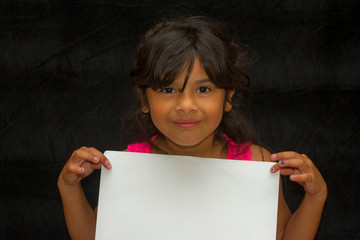 Girl with blank paper
