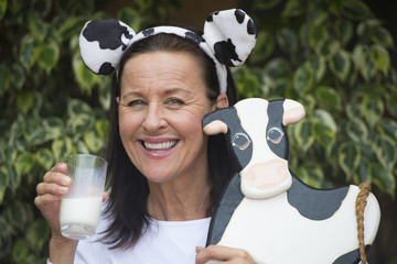 Friendly mature woman with milksop and cow