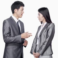 Businessman talking to businesswoman
