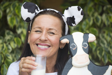 Funny mature woman with milksop and cow