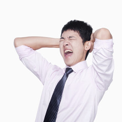 Frustrated businessman holding his head