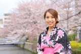 Japanese woman wearing kimono with cherry blossom