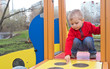 little boy on outdoor playground