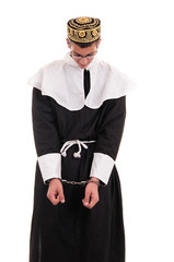 young man with handcuffs costumed in nun for fun, funny religiou