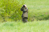 Wildlife photographer with long telephoto