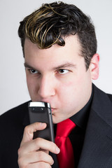 Thoughtful businessman with phone