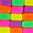 Wall background made of colorful child's play clay bricks