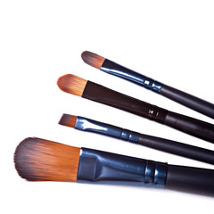 cosmetic brushes on white