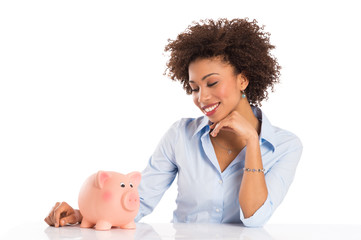Young Woman Looking At Piggybank