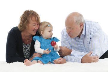 grandparents with granddaughter, isolated on white