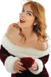 Beautiful girl wearing Santa Claus clothes with red gift box