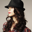 Beautiful brunette girl with classic hat