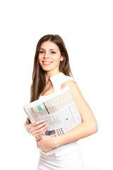 Attractive young woman posing with a newspaper on a white backgr