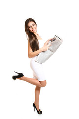 Beautiful young woman posing with a newspaper on a white backgro