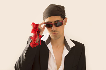 parody of a Latin lover with a garter red  in hand