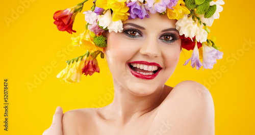 Woman with hairstyle and flower. Isolated on yellow